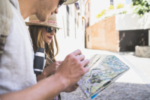 tourists-looking-map_23-2147641153